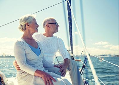 mature couple sitting on a sailboat